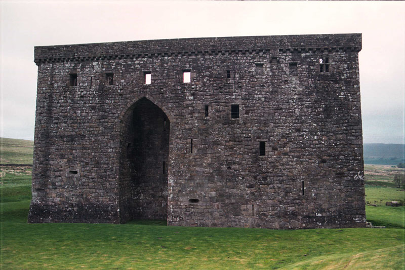 from the front, a monolithic, defensible stone wall