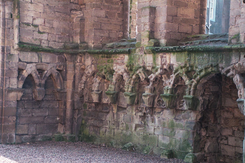 remains of arcade arching, which might be part of the cloister, or benches in a chamber