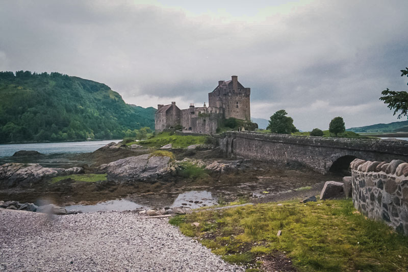 with the tide out, the castle sits on a rocky islet