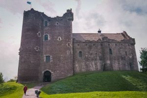 facade of doune is dominated by tall tower