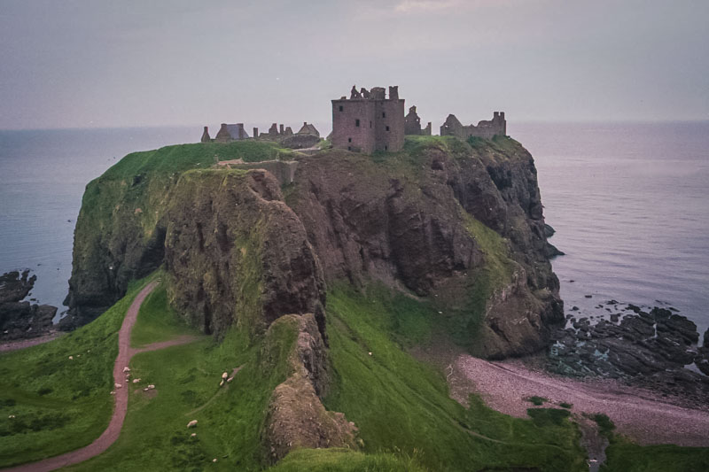 dunnottar castle on the rocky cliffs jutting into the sea