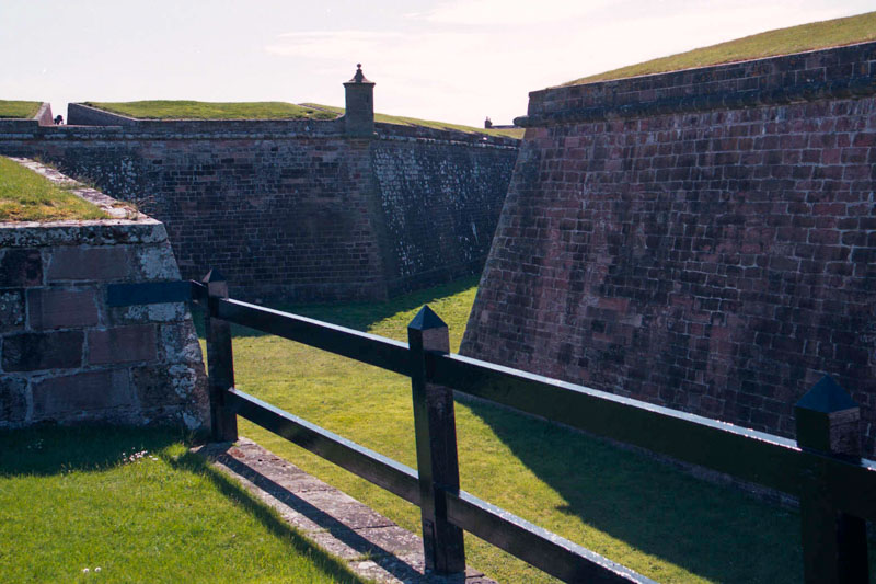 The deep ditches and earthen walls that fortify the fort on the landward side