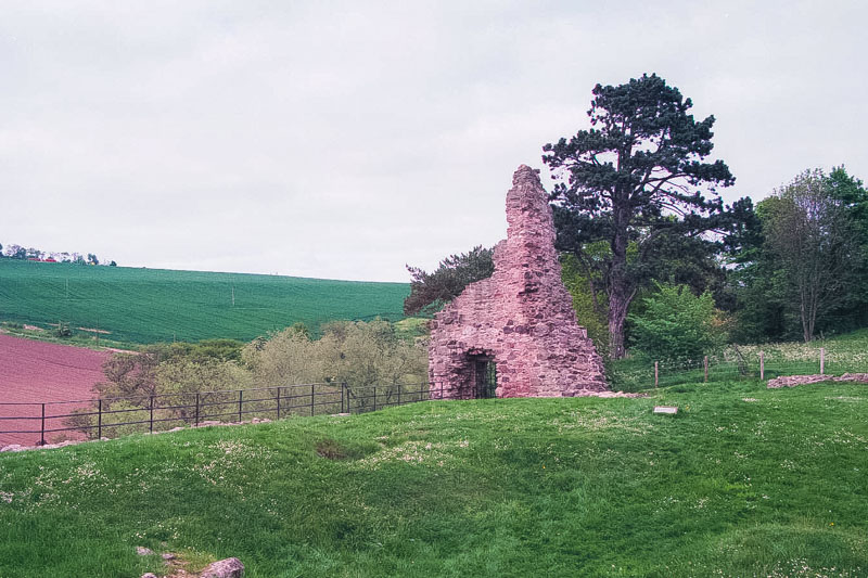 at the far end of the courtyard, possibly the remains of the bakehouse