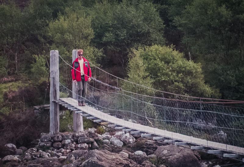 Mark walking back across the little bridge