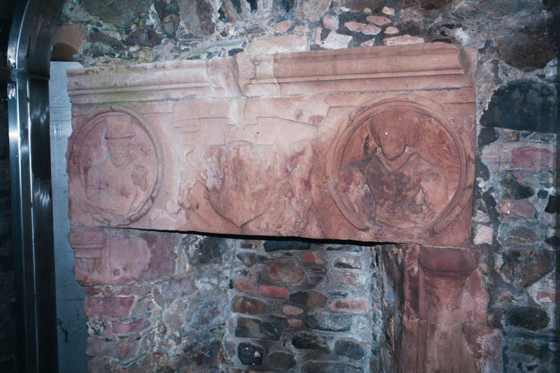 an elaborately carved fireplace in the hall