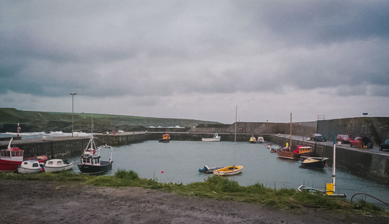 the harbor, with small boats bouncing int the waves