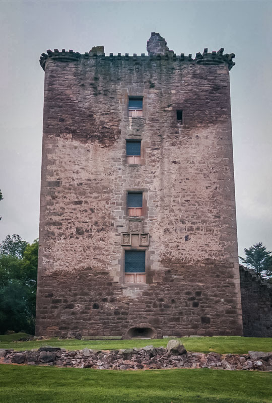 the nearly complete wall of the main tower, marred by damp