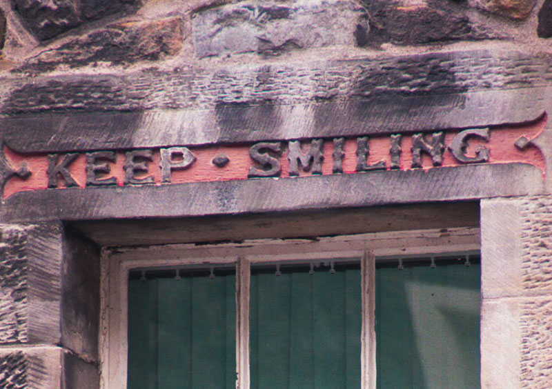 one of the many carved adages on the boy's club building