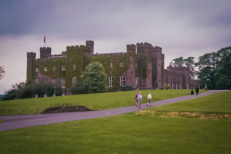 the imposing facade of Scone palace blooms red in summer